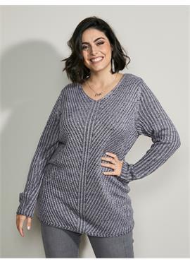 Пятнистый свитер