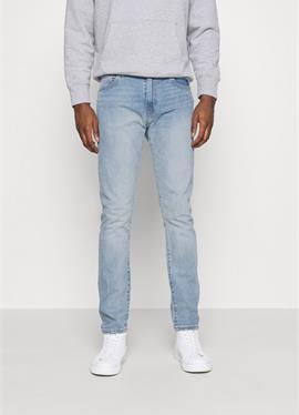 512™ SLIM TAPER - джинсы зауженный крой