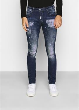 MIRANO CARROT FIT - джинсы зауженный крой